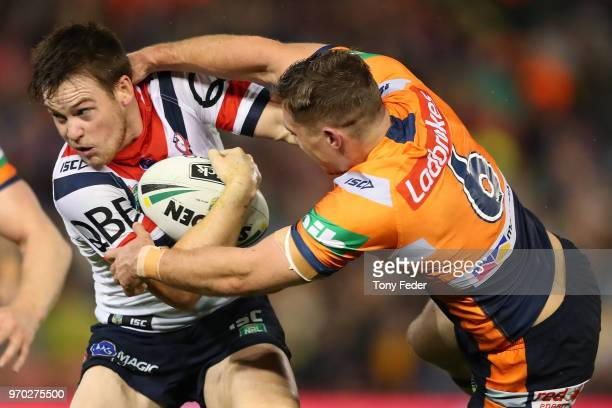 Luke Keary of the Roosters is tackled during the round 14 NRL match between the Newcastle Knights and the Sydney Roosters at McDonald Jones Stadium...