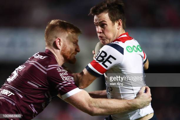 Luke Keary of the Roosters is tackled during the round 19 NRL match between the Manly Sea Eagles and the Sydney Roosters at Lottoland on July 22 2018...