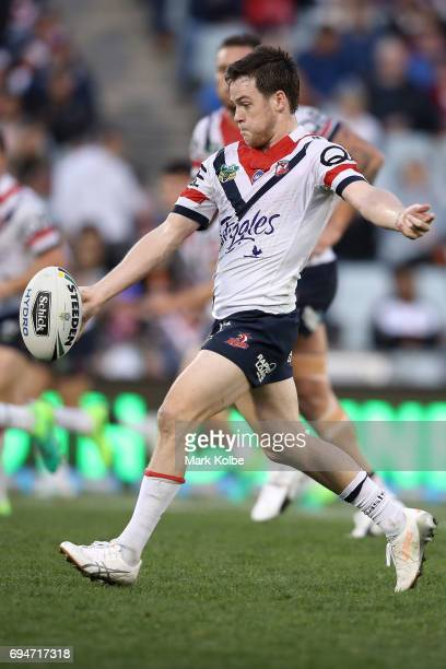 Luke Keary of the Roosters kicks during the round 14 NRL match between between the Wests Tigers and the Sydney Roosters at Campbelltown Sports...