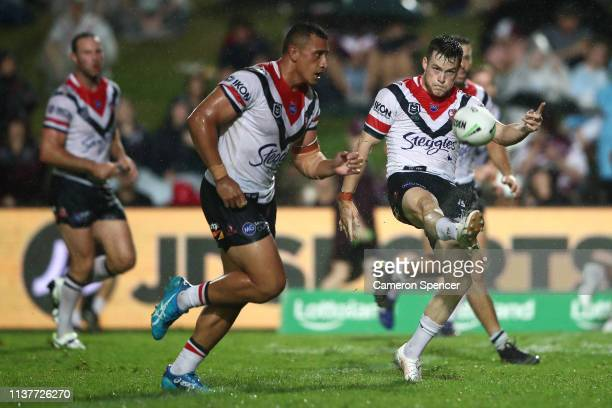 Luke Keary of the Roosters kicks during the round two NRL match between the Manly Sea Eagles and the Sydney Roosters at Lottoland on March 23 2019 in...