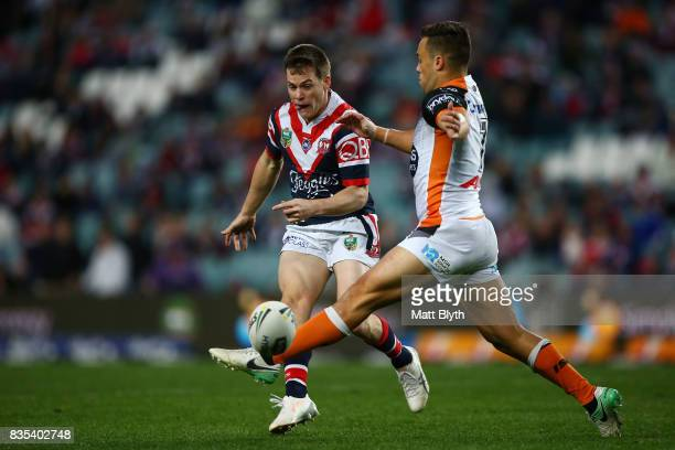Luke Keary of the Roosters kicks the ball during the round 24 NRL match between the Sydney Roosters and the Wests Tigers at Allianz Stadium on August...