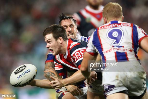 Luke Keary of the Roosters offloads the ball during the round three NRL match between the Sydney Roosters and the Newcastle Knights at Allianz...