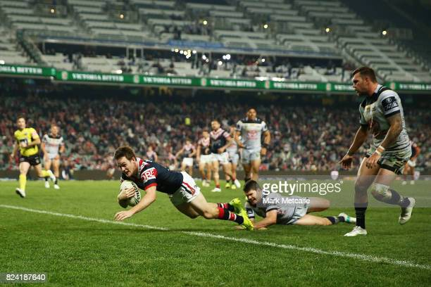 Luke Keary of the Roosters scores a try during the round 21 NRL match between the Sydney Roosters and the North Queensland Cowboys at Allianz Stadium...