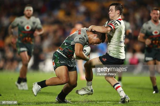 Luke Keary of the Roosters tackles Mason Lino of the Warriors during the round 10 NRL match between the New Zealand Warriors and the Sydney Roosters...