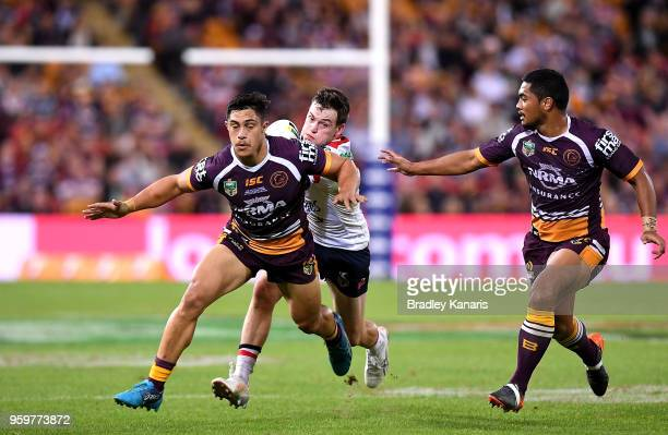 Luke Keary of the Roosters takes on the defence during the round 11 NRL match between the Brisbane Broncos and the Sydney Roosters at Suncorp Stadium...