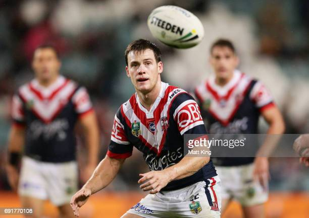 Luke Keary of the Roosters takes the ball during the round 13 NRL match between the Sydney Roosters and the Brisbane Broncos at Allianz Stadium on...