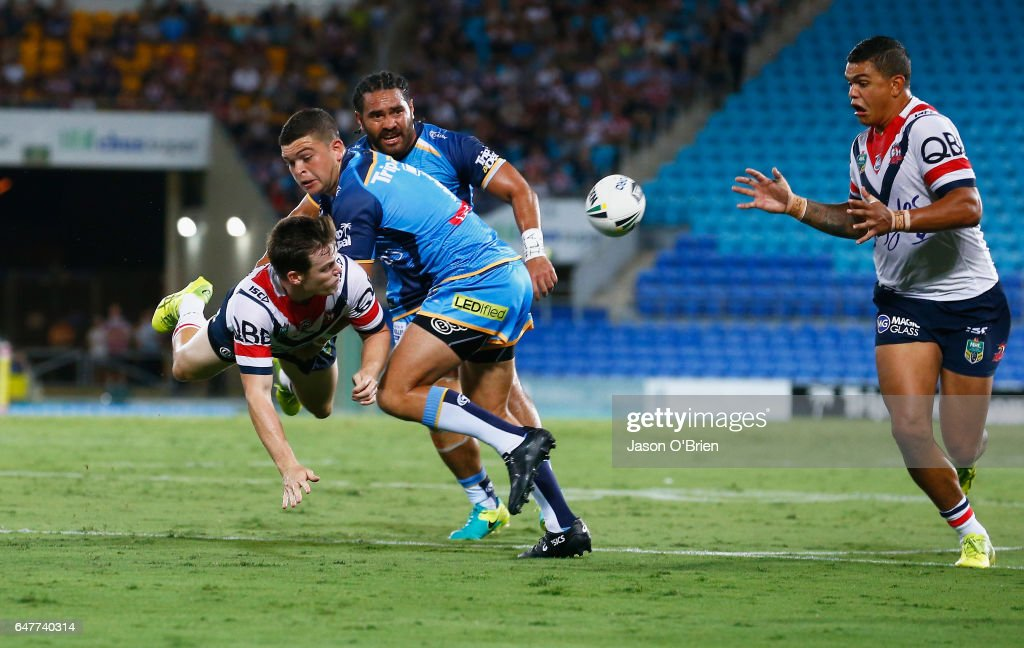 Luke Keary of the Roosters throws a pass during the round one NRL match between the Gold Coast Titans and the Sydney Roosters at Cbus Super Stadium on March 4, 2017 in Gold Coast, Australia.