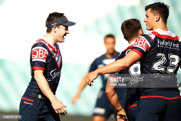 Luke Keary shares a laugh with during a Sydney Roosters NRL training session at Kippax Lake Oval on September 18 2018 in Sydney Australia