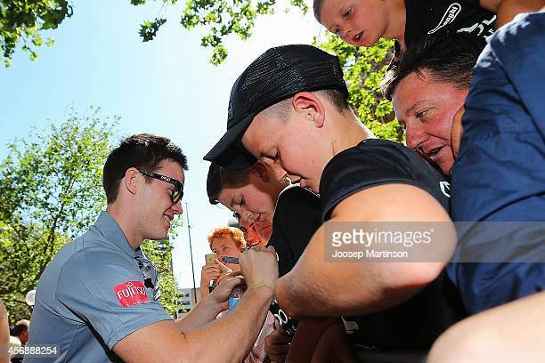 Luke Keary signs autographs during a South Sydney Rabbitohs NRL Grand Final celebration at Sydney Town Hall on October 9 2014 in Sydney Australia