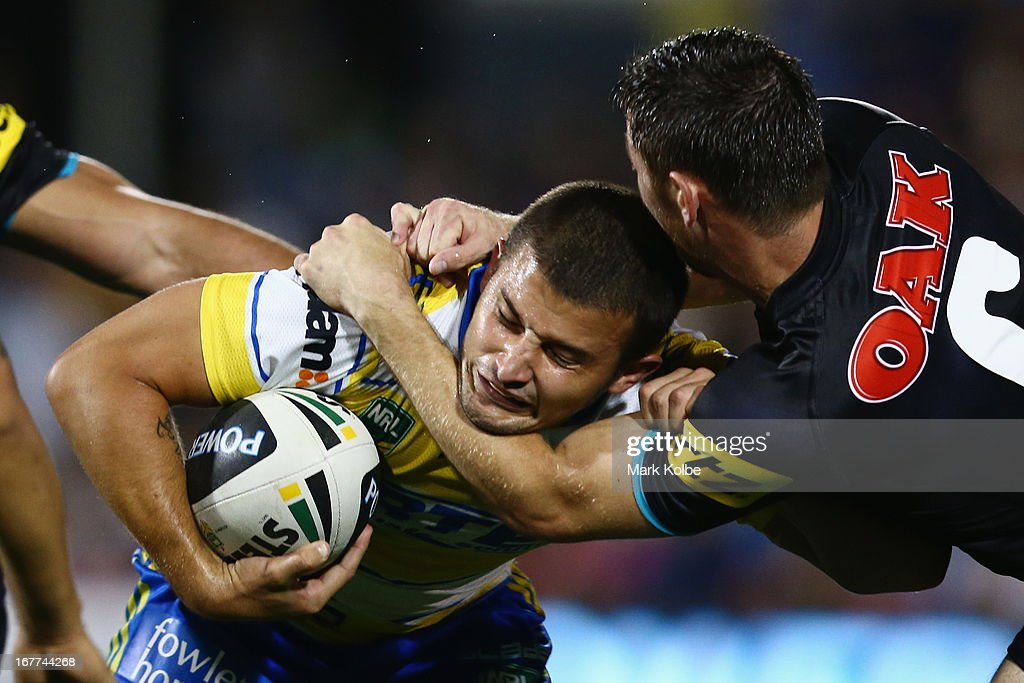 Luke Kelly of the Eels is tackled high by Tom Humble of the Panthers on his way to scoring a try during the round seven NRL match between the Penrith Panthers and the Parramatta Eels at Centrebet Stadium on April 29, 2013 in Penrith, Australia.