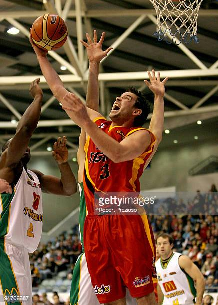 Luke Kendall of the Tigers drives to the basket during the round three NBL match between the Melbourne Tigers and the Townsville Crocodiles on...