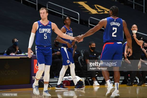 December 11: Luke Kennard and Kawhi Leonard of the LA Clippers hi-five during a preseason game against the Los Angeles Lakers on December 11, 2020 at...