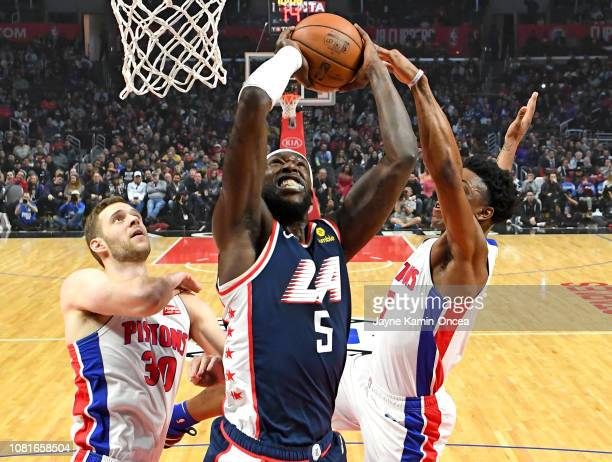 Luke Kennard and Stanley Johnson of the Detroit Pistons defend as Montrezl Harrell of the Los Angeles Clippers goes for a dunk in the first half of...