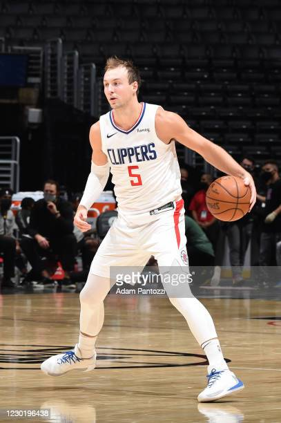 Luke Kennard of the LA Clippers handles the ball against the Utah Jazz during a preseason game on December 17, 2020 at STAPLES Center in Los Angeles,...
