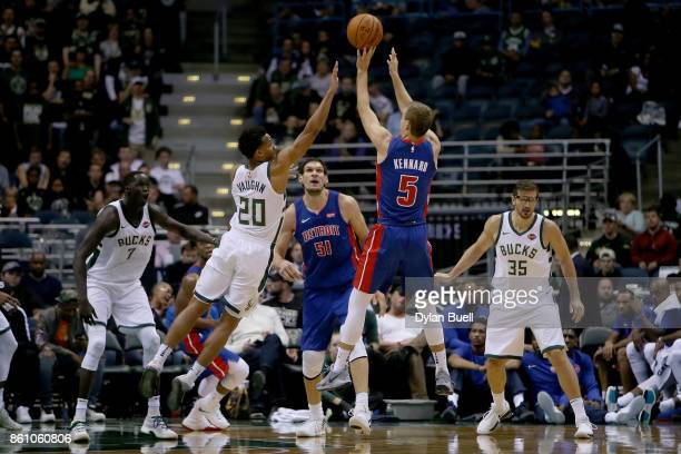 Luke Kennard of the Detroit Pistons attempts a shot over Rashad Vaughn of the Milwaukee Bucks in the second quarter during a preseason game at BMO...