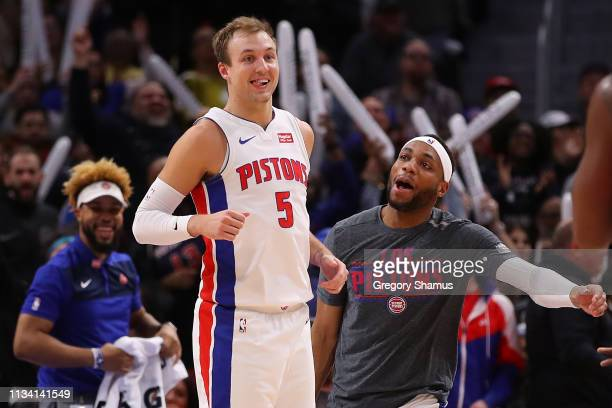 Luke Kennard of the Detroit Pistons celebrates a second half three point basket with Bruce Brown while playing the Minnesota Timberwolves at Little...