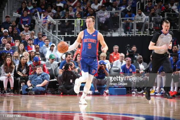 Luke Kennard of the Detroit Pistons dribbles the ball during the game against the Charlotte Hornets on April 7, 2019 at Little Caesars Arena in...