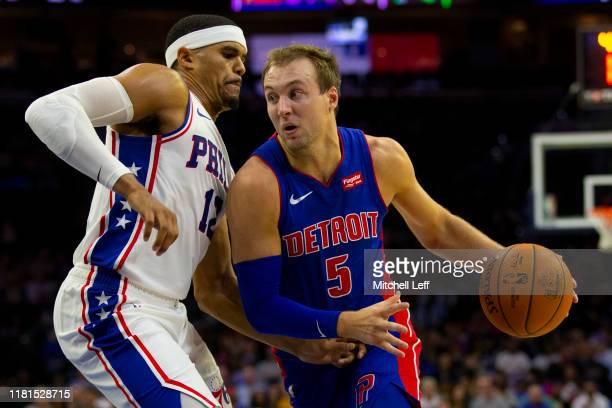 Luke Kennard of the Detroit Pistons drives to the basket against Tobias Harris of the Philadelphia 76ers during the preseason game at the Wells Fargo...