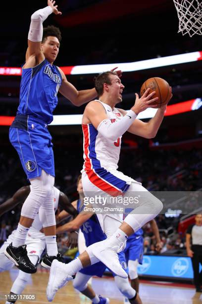 Luke Kennard of the Detroit Pistons drives to the basket past Isaih Roby of the Dallas Mavericks during the second half at Little Caesars Arena on...