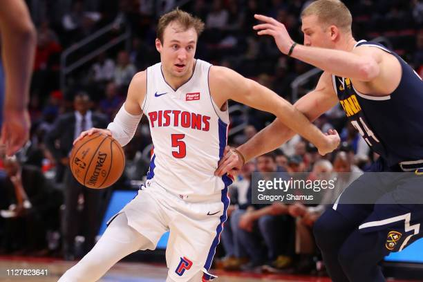 Luke Kennard of the Detroit Pistons drives to the basket while playing the Denver Nuggets at Little Caesars Arena on February 04, 2019 in Detroit,...