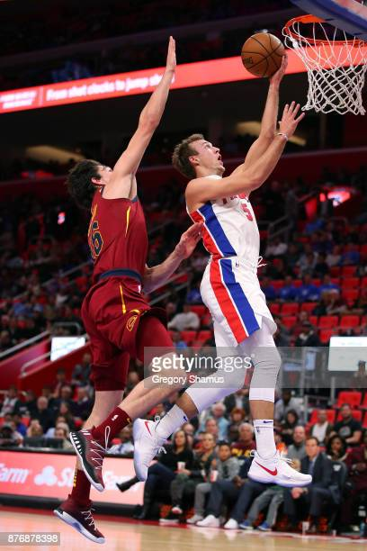 Luke Kennard of the Detroit Pistons gets to the basket past Cedi Osman of the Cleveland Cavaliers during the second half at Little Caesars Arena on...