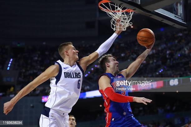 Luke Kennard of the Detroit Pistons handles the ball against Kristaps Porzingis of the Dallas Mavericks during a game between Dallas Mavericks and...