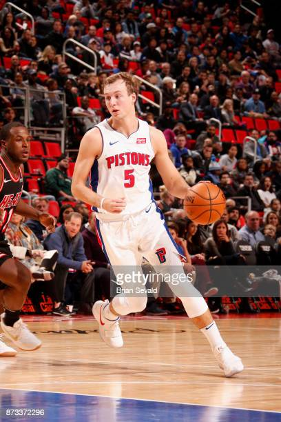 Luke Kennard of the Detroit Pistons handles the ball against the Miami Heat on November 12 2017 at Little Caesars Arena in Detroit Michigan NOTE TO...