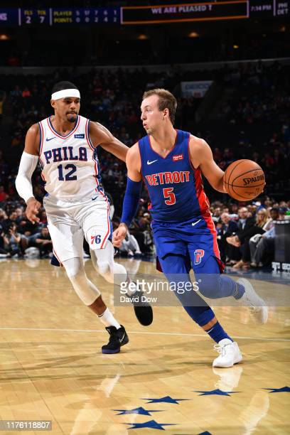 Luke Kennard of the Detroit Pistons handles the ball against Tobias Harris of the Philadelphia 76ers during a preseason game on October 15 2019 at...