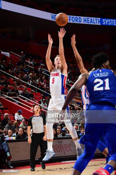 Luke Kennard of the Detroit Pistons shoots the ball against the Philadelphia 76ers on October 23 2017 at Little Caesars Arena in Detroit Michigan...