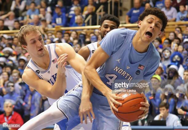 Luke Kennard of the Duke Blue Devils battles for a loose ball against Justin Jackson of the North Carolina Tar Heels during their game at Cameron...