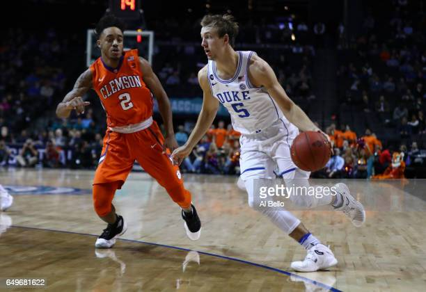 Luke Kennard of the Duke Blue Devils drives against Marcquise Reed of the Clemson Tigers during the second round of the ACC Basketball Tournament at...