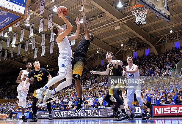 Luke Kennard of the Duke Blue Devils drives to the basket against Isaac Johnson of the Appalachian State Mountaineers during the game at Cameron...