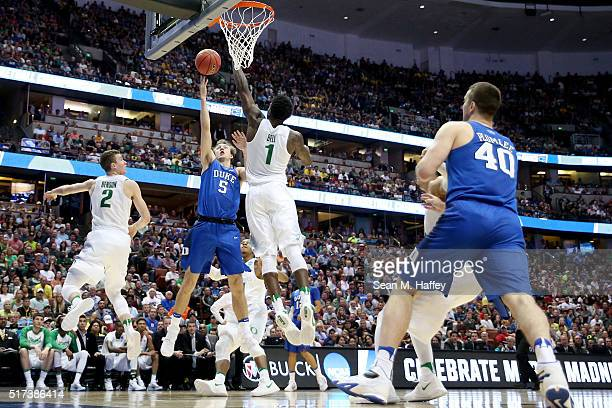 Luke Kennard of the Duke Blue Devils goes up for a shot over Jordan Bell of the Oregon Ducks in the second half in the 2016 NCAA Men's Basketball...