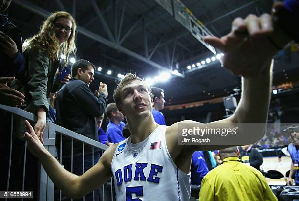 Luke Kennard of the Duke Blue Devils greets fans after defeating the Yale Bulldogs 71-64 during the second round of the 2016 NCAA Men's Basketball...