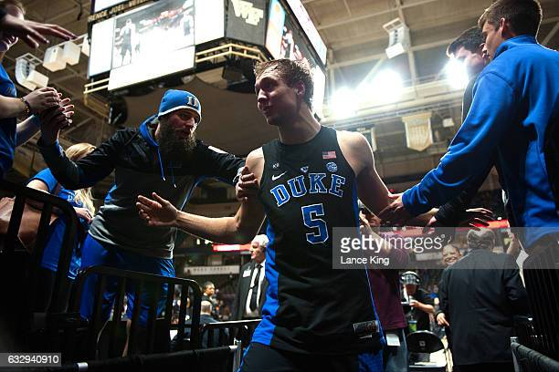Luke Kennard of the Duke Blue Devils highfives fans following their 8583 win against the Wake Forest Demon Deacons at LJVM Coliseum Complex on...