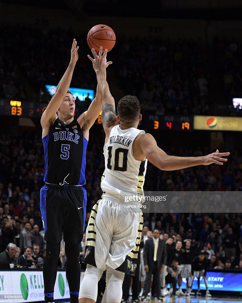 Luke Kennard #5 of the Duke Blue Devils puts up the game-winning three-point shot with 6.6 seconds remaining in the game against Mitchell Wilbekin #10 of the Wake Forest Demon Deacons at LJVM Coliseum Complex on January 28, 2017 in Winston-Salem, North Carolina. Duke won 85-83.