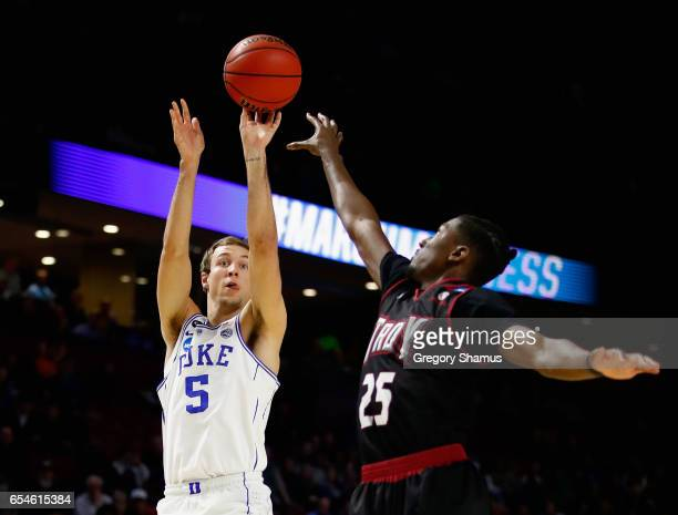 Luke Kennard of the Duke Blue Devils shoots against DeVon Walker of the Troy Trojans in the first half during the first round of the 2017 NCAA Men's...