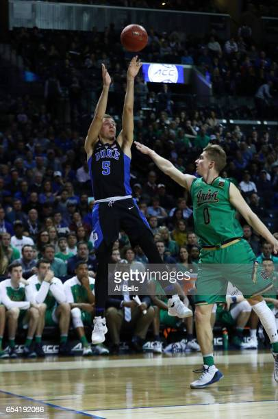Luke Kennard of the Duke Blue Devils shoots against Rex Pflueger of the Notre Dame Fighting Irish during the championship of the ACC Basketball...