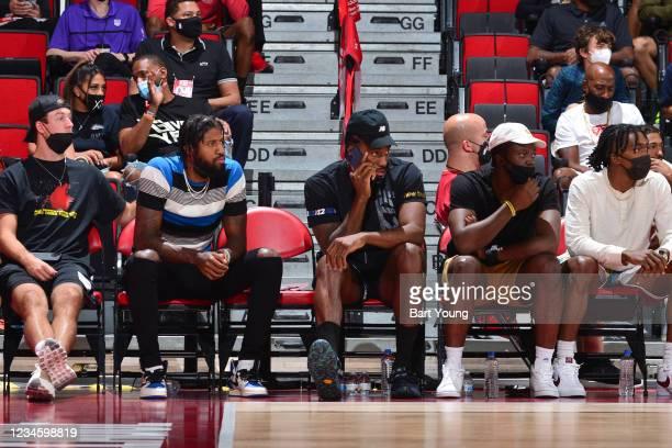 Luke Kennard, Paul George, Kawhi Leonard, Reggie Jackson, and Terance Mann of the LA Clippers look on during the 2021 Las Vegas Summer League on...