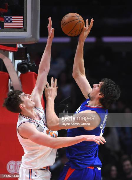 Luke Kornet of the New York Knicks blocks a shot by Boban Marjanovic of the Los Angeles Clippers in the second half of the game at Staples Center on...