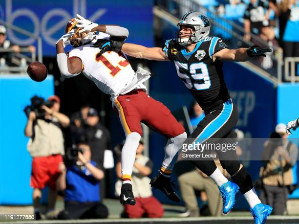 Luke Kuechly of the Carolina Panthers breaks up a pass to Kelvin Harmon of the Washington Redskins during their game at Bank of America Stadium on...