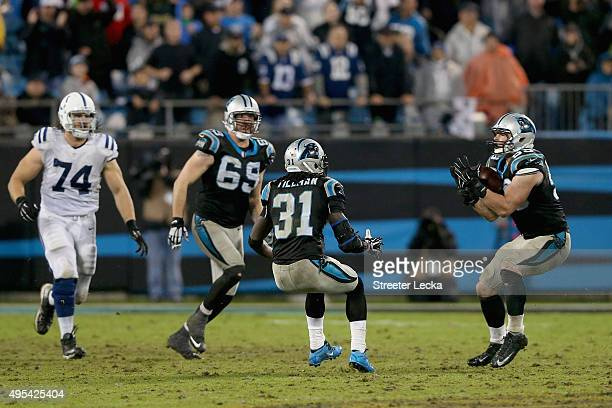Luke Kuechly of the Carolina Panthers catches an inteception in overtime against the Indianapolis Colts during their game at Bank of America Stadium...