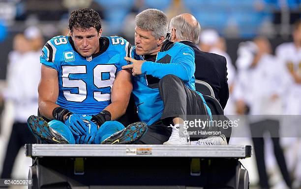 Luke Kuechly of the Carolina Panthers is carried off the field after an injury against the New Orleans Saints in the fourth quarter during the game...