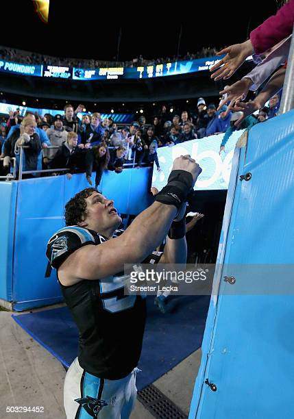 Luke Kuechly of the Carolina Panthers signs autographs for fans after their game against the Tampa Bay Buccaneers during their game at Bank of...