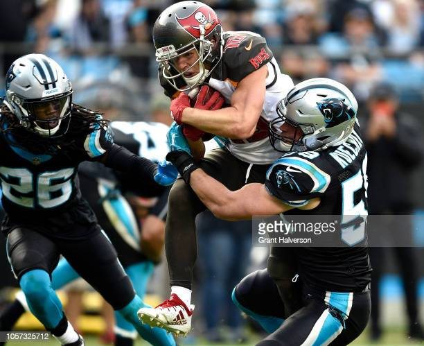 Luke Kuechly of the Carolina Panthers tackles Adam Humphries of the Tampa Bay Buccaneers during the fourth quarter of their game at Bank of America...