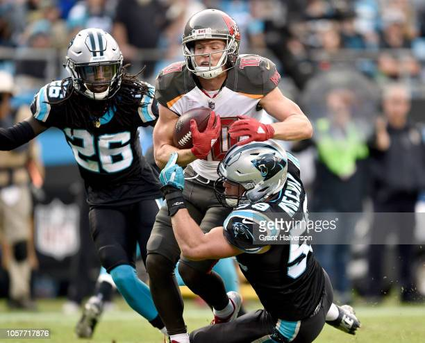 Luke Kuechly of the Carolina Panthers tackles Adam Humphries of the Tampa Bay Buccaneers during their game at Bank of America Stadium on November 4...