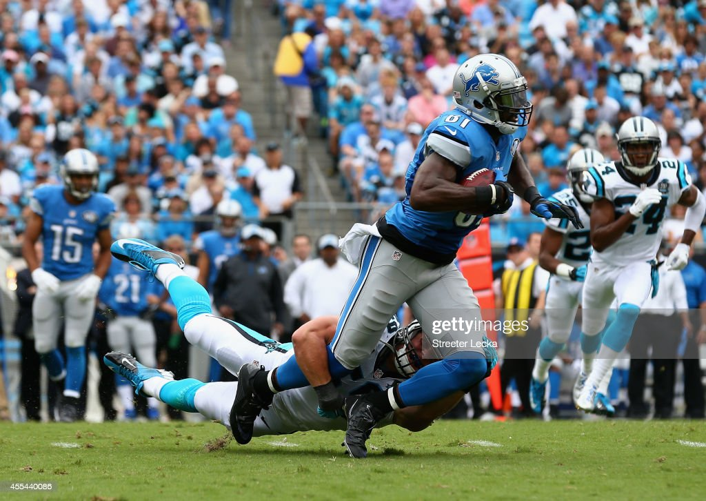 Luke Kuechly #59 of the Carolina Panthers tackles Calvin Johnson #81 of the Detroit Lions during the game at Bank of America Stadium on September 14, 2014 in Charlotte, North Carolina.