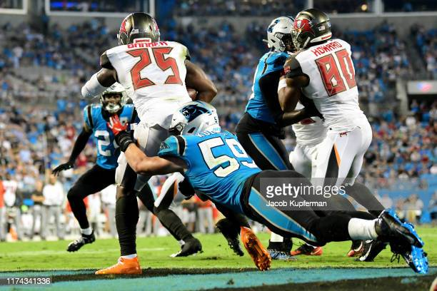 Luke Kuechly of the Carolina Panthers tackles Peyton Barber of the Tampa Bay Buccaneers for a safety in the fourth quarter during their game at Bank...