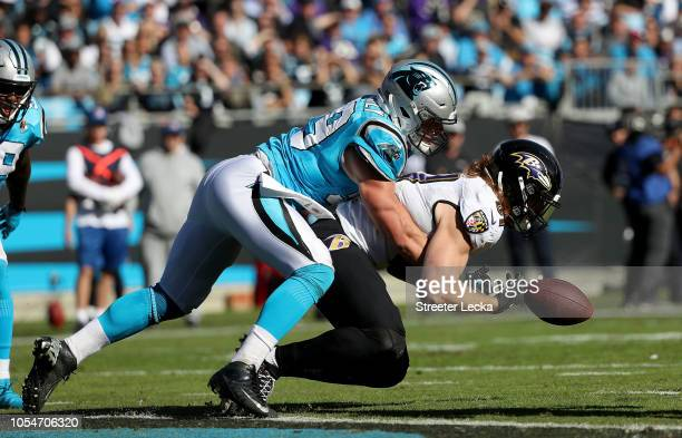 Luke Kuechly of the Carolina Panthers tackles Willie Snead of the Baltimore Ravens in the third quarter during their game at Bank of America Stadium...