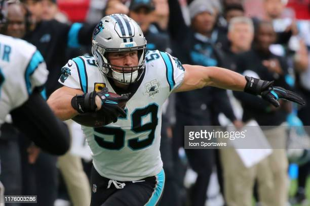 Luke Kuechly of the Panthers intercepts a pass and carries the ball to just short of the end zone during the game between the Carolina Panthers and...